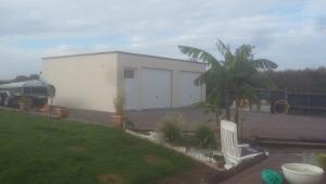 Double garage béton toit terrasse