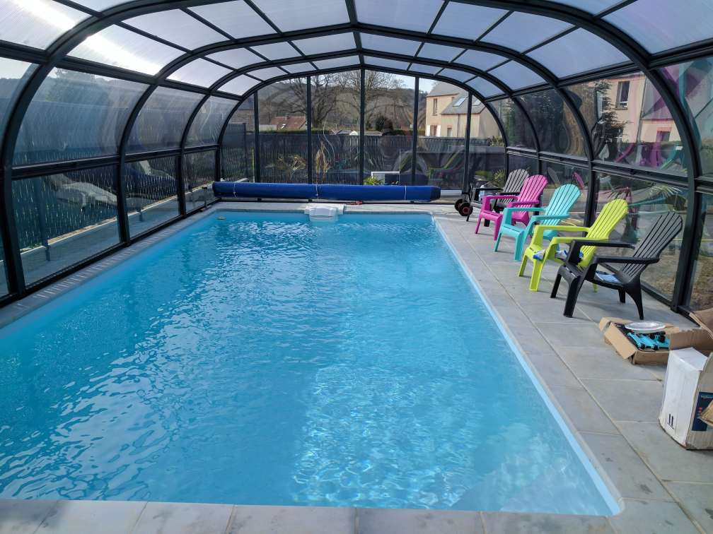 Abris hauts un espace autour de votre piscine kopec for Abri de piscine 33